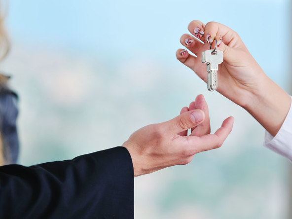 man handing over apartment keys in grand cayman